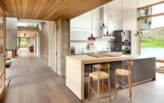 In this kitchen, pendant lights highlight the island that has a small dining space attached.