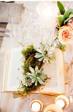 I know you expressed some interest in using moss--this would be really easy to do and would be a great addition to the tablescape. You don't have to put it on books either--the moss could rest on something else (like those branches you were going to use) or you can just put this directly on the table.