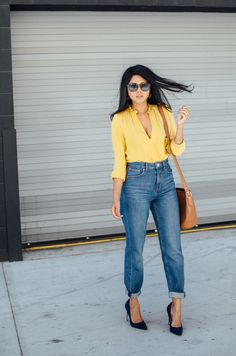 plunging mustard tblouse with boyfriend jeans