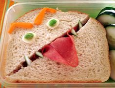 I really love this idea.  Children can create all kinds of monsters and then eat them for lunch.  Here are some books that can be read before eating their creations! :)     Hungry Monsters: A Pop-Up Book of Colors; Matt Mitter (Author), Jo Brown (Illustrator) and  Go Away, Big Green Monster!  Ed Emberley (Author)
