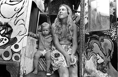 Motherhood at Woodstock...  toddler with only one shoe!