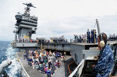 PACIFIC OCEAN (Aug. 24, 2013) An aircraft elevator is raised from the hangar bay to the flight deck of the U.S. Navy's forward-deployed aircraft carrier USS George Washington (CVN 73) during a friends and family day cruise. (U.S. Navy photo by Mass Communication Specialist 3rd Class Paolo Bayas/Released)