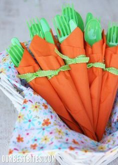 Carrot Napkin Bundles for Easter Dinner. Orange napkins and green plastic silver wear. Cute idea!