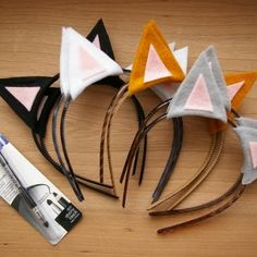 DIY: Cheap headbands and felt, glue gun, and some eyeliner to draw on whiskers…
