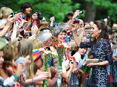 The Duchess of Cambridge charms the enthusiastic crowd of about 6,000 during a leisurely walkabout at Rideau Hall – the home to Canada's Governor General and the site of Kate and William's official welcoming ceremony.