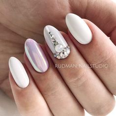 White Shellac Nails Designs With Rhinestones For A Classy And Elegant Look #whitenails #ovalnails #rhinestonesnails #chromenails ★ Have you tried shellac nails already? Discover plenty of pretty designs for shellac manicure here. ★ See more: https://glaminati.com/shellac-nails/ #glaminati #lifestyle #nails #nailart #naildesigns #shellacnails