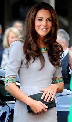 Catherine, Duchess of Cambridge in a custom Mathew Williamson creation. Love this dress. The peplum waisted dress with tribal accents was a perfect choice for the premiere of Disney's African Cats.