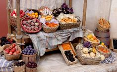French Market Stall, by Polly Morris. Close-up of produce-- the baskets and barrels were painted in the same shade to keep the focus on the polymer clay fruits and vegetables.