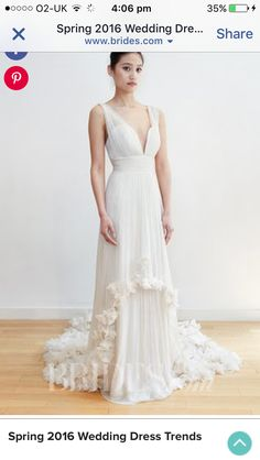 2220224353c Chiffon sheath with plunging neckline and floral appliqués at the hem