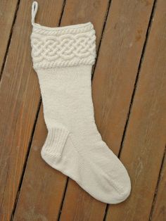 Glendalough Stocking by Donna Arney A braided celtic cable adorns this simple-yet-elegant holiday stocking. The braid panel is worked flat and joined into a ring, then the body of the stocking is worked in the round. Knit Stockings, Knitted Christmas Stockings, Christmas Knitting, Christmas Sewing, Weaving Patterns, Knitting Patterns, Knitting Ideas, Yarn Projects, Knitting Projects