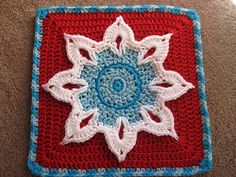 """Here is my 12"""" version of the Sun motif from my September Morning Afghan. Three-dimensional leaves surrounding a textured center, on a solid double-crochet base. Final round in tapestry crochet technique."""