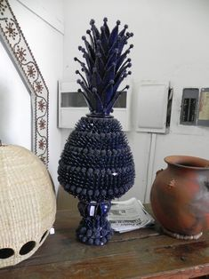 """With the opening of the Feria Maestros del Arte, I thought it might be timely to post on this """"Art Treasure"""" from Michoacan. Pineapple Vase, Mexican Ceramics, Pottery Videos, Southwestern Decorating, Palm Sunday, Hacienda Style, Arte Popular, Mexican Folk Art, Central America"""
