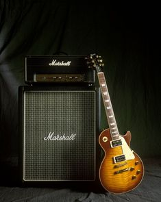 A iconic shot of a Marshall amp next to a Gibson SG guitar. (740×927)