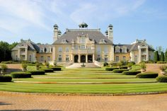 House reportedly spent $26 million building this French-chateau-style home on 27 acres; the guitar-shaped driveway was reportedly his whimsical idea. Description from celebrityhouses-andmansions.blogspot.com. I searched for this on bing.com/images