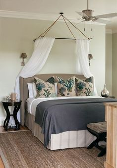 color scheme:  pale green (probably Donald Kaufman); grey coverlet; teal + cream pillows; taupe headboard; seagrass rug; bench; side table; reading lights