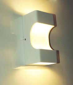 Modern yet functional. The Oslo Wall light is an ultra-modern fitting that is ideal for creating ambient light in a room.  The low energy, long life LED chips project light from the top, bottom and front of the open box design for increased illumination. Mount multiple to the wall to achieve desired effect.