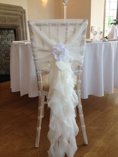 Our pretty chair hoods.. perfect for the chiavari! Thanks to Stacey from South West Chair Covers