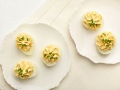 Truffled Deviled Eggs :  Whip truffle oil and black truffle shavings into mashed yolks until very light and fluffy. If you want more truffle flavor, add a little more truffle oil. Proceed with caution though, as it is very easy to over-truffle.