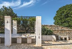 In the shade of ancient olive trees, in the heart of the Itria Valley, the Masseria Le Carrube, formerly an agricultural farm, planted on land washed with sea Mediterranean Architecture, Mediterranean Style, Banquettes, Porches, Transformers, Italian Villa, Indoor Outdoor, Outdoor Decor, Villa Design