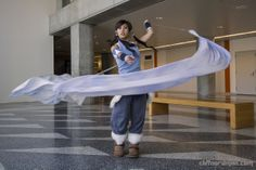 Seriously awesome Legend of Korra cosplay! It is so awesome how they made a sheet of water to look like the cosplayer was actually water bending!!!! That, my friends, is bloody BRILLIANT!!!!!!