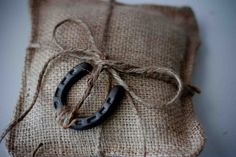 ring bearer  pillow of burlap and twine replace the horse shoe with the wooden heart or maybe a wooden leaf