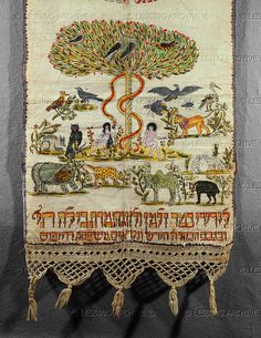 Seder towel,for use after the ritual washing of hands during the Seder dinner. The towel belonged to the Dreyfus family and shows Adam and Eve in Paradise. From Alsace, France, 1829. Drawing and watercolour on linen with fringe of open weave, 141 x 14,5 cm   The Jewish Museum, New York, USA