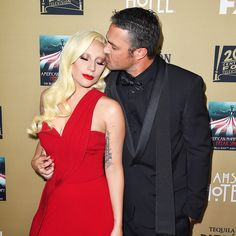 Lady Gaga and her fiancé, Chicago Fire star Taylor Kinney, shared some serious PDA on the red carpet for the American Horror Story: Hotel premiere on Saturday, Oct. 3.