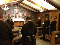 Friars praying in the friary chapel