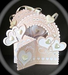 Silhouette cutting file Wedding on Craftsuprint designed by Carol Dunne - made by Cynthia Massey - Cut out on my Cameo cutting machine, left off the horseshoes but added extra hearts with padded cream hearts in the centres and some extra padded hearts, a few pearls just finishes off this gorgeous elegant wedding card, the machine and the designer do all the hard work, just so easy! - Now available for download!