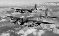 A pair of de Havilland Mosquitos in flight
