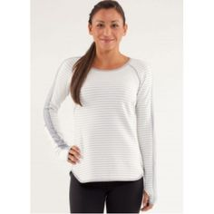 Runder Under Reversible Long Sleeve Pullover Running luon top called the Runder Under in Macro Micro Stripe Polar Cream / Silver Slate. Reversible to dark grey. No pull tag, but it's very big on me and I'm usually a 6. I would guess it's a 10. I will measure tonight and add actual pictures. lululemon athletica Tops
