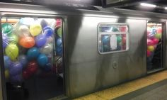 a subway car packed full of balloons!