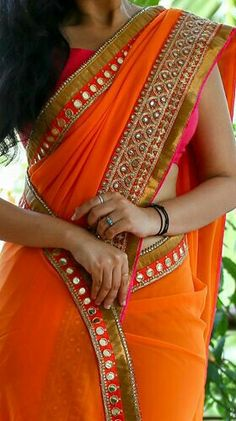 New style Orenge.. golden borderd mirror worked saree