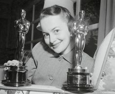 """Olivia with her oscars for """"The Heiress"""" and """"To Each His Own"""""""