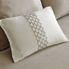 this pillow is not longer available - there are 2 sizes of buttons and the larger ones must be fabric covered.  Isn't it elegantly simple????