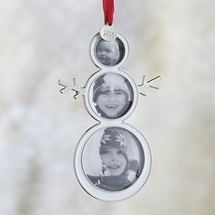 Our sweet snowman frame ornament is the perfect way to commemorate the holidays. The clean snowman design stacks three of the year's favorite images. Not only a great ornament, the frame is also makes a fun and festive present topper or placecard holder! Adorned with a 2015 charm, this frame will house memories that will last a lifetime.