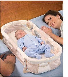 Co-sleeper. so you aren't afraid of rolling onto the baby!