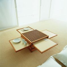Asian-style-square-small-center-table-floor-sitting-with-sliding-planks-for-save-space