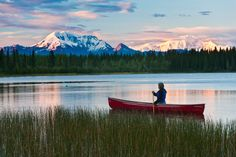 Canoeing on a lake at dusk in Alaska.