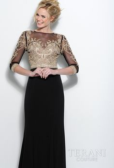 Jersey sheath with sweetheart neckline and a roman inspired, crystal embellished mesh overlay covering the bodice and 3/4 sleeves, it is finished with a ring of embelishment over the cuff and around the waist