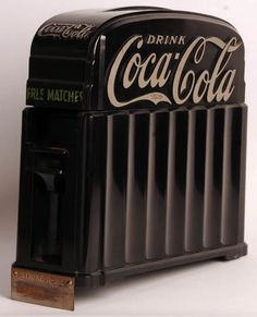 "Coca Cola 1933 Bakelite Match Dispenser. To say this piece is rare is an understatement. Very unusual piece, front has ""Press"" lever which, when pressed dispenses a stick match. Striker is at bottom which overlaps the counter. High Relieve Drink Coca-Cola on four sides is painted silver to give a dramatic look to this truly Art-Deco piece of art.. It seems odd calling an advertising match dispenser a piece of art, but that is exactly what this is."