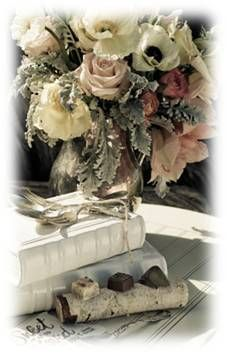 Vintage Pastel Arrangement with blush pink roses and anemone with vintage books.