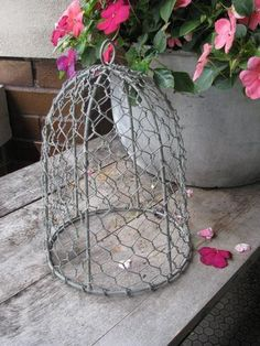 Add a fun accent to your home when you cover a plant or candle with our Chicken Wire Cloche. Shop for home decor accents by visiting the Quilt Shop now. https://www.primitivestarquiltshop.com/collections/farmhouse-primitives/products/chicken-wire-cloche #primitivefarmhousedecor