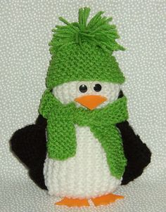 Free Knitting Pattern for Stacey's Perfect Penguin - This bean-bag penguin softie toy by Messmerland Knitting is an easy pattern knit in garter stitch and embellished with safety eyes, felt feet and bill. Comes with patterns for her own scarf and hat!