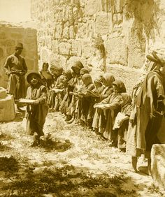 Nablus - نابلس : NABLUS - Late 19th, early 20th c. 106 - A line of little Arab children with their writing boards at madrasa, Nablus area