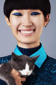 Chen Xi in Jil Sander with a furry friend photographed by BriAnne Wills for Teen Vogue, September 2015.