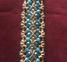 This is a youTube tutorila by Claudia Angelini. You can watch the tutorial HERE Materials : 8/0 and 11/0 Seed Beads Superduos 6X8 ...