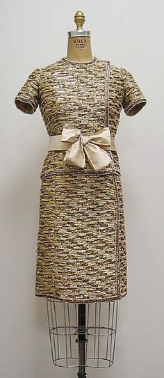 """Suit House of Chanel (French, founded 1913) Designer: Gabrielle """"Coco"""" Chanel (French, Saumur 1883–1971 Paris) Date: ca. 1964 Culture: French Medium: a, b) silk, plastic, straw, metal, synthetic; c) silk"""