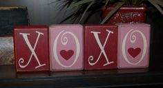 VALENTINES Day Primitive Blocks XOXO Hugs and Kisses Valentine Word Blocks Sign Distressed Stacking Shelf Blocks Home Decor Gift. $19.95, via Etsy.