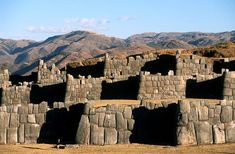 Sacsahuaman, Peru - believed to have once been a royal retreat, a fortress, or both. Its zigzag walls are built with some of the largest stones to be found in Inca masonry; some are estimated to weigh as much as 300 tons, yet are fit together as tightly as the pieces of a jigsaw puzzle.  An amazing place!